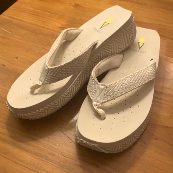 Volatile tan and white sandal